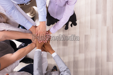 team stacking their hands