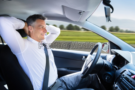 relaxed man sitting in self driving