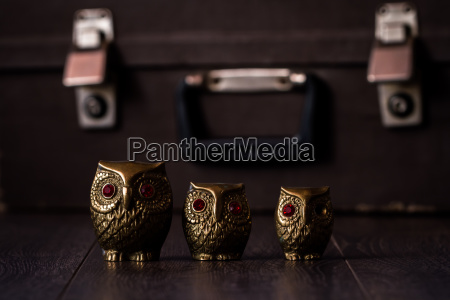 vintage brass owl figurines on brown
