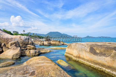 rock and the blue sea at