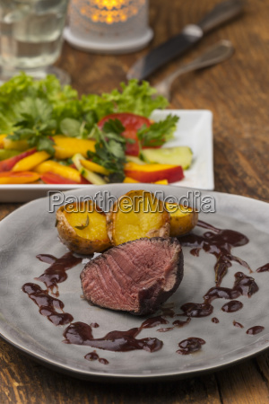 grilled steak on a grey plate