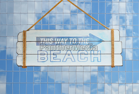 way to beach sign over glass