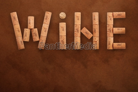 word wine shaped by corks on