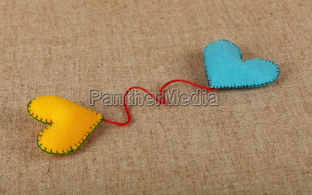 two felt craft hearts yellow and