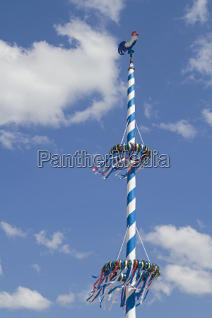 bavarian maypole in front of white