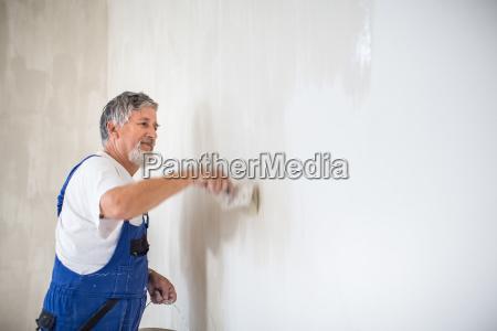 senior painter man at work with