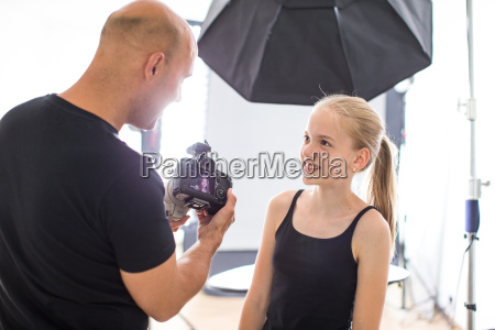 teenage fashion model being shot by