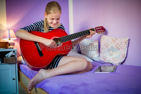 teenage girl with her guitar in