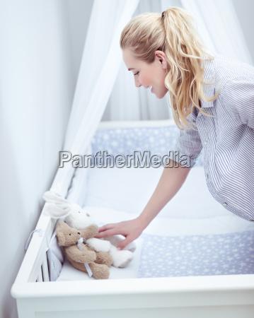 future mom prepares childs room