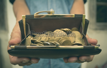 male holding wallet with money gold