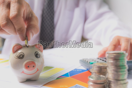 hand of businessman holding coin and