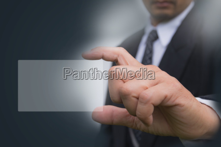 hand of businessman holding the white
