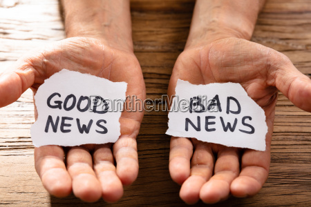 man showing paper with good and