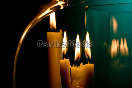four candles reflected