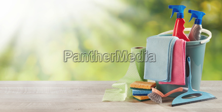 household cleaning supplies on a garden