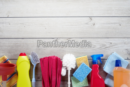 border of assorted household cleaning supplies