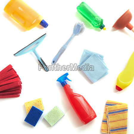 scattered cleaning products on a white