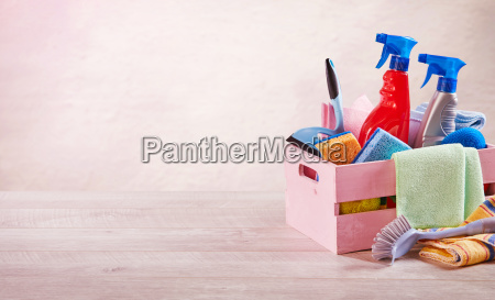 pink wooden crate with household cleaning