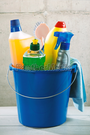 blue plastic bucket filled with cleaning