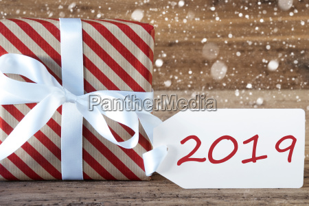 red present with snowflakes text 2019