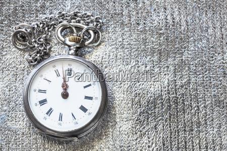 vintage pocket watch on silver textile