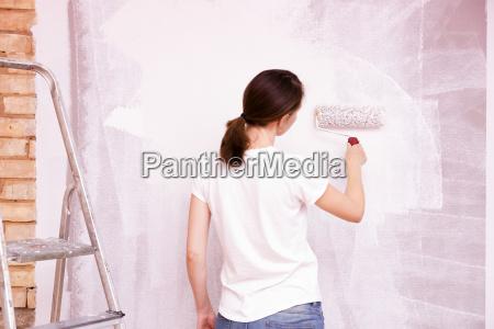 home improvement beautiful woman painting wall