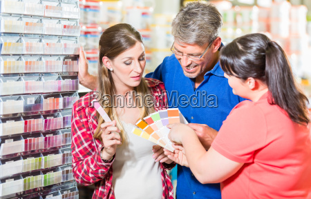 home improvement store clerk counseling customers