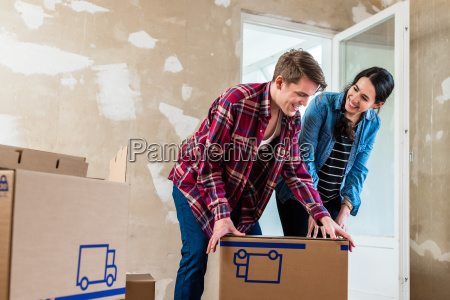 young couple opening boxes during renovation