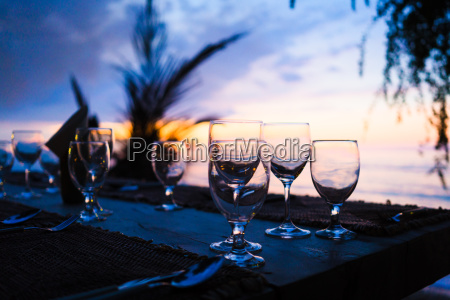 glasses on table in tropical restaurant