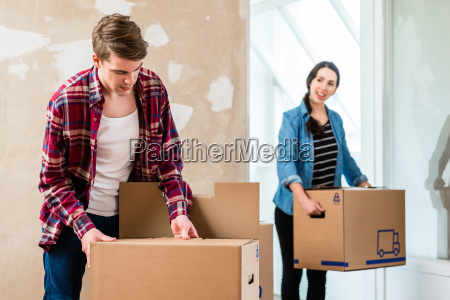 young man opening a box while