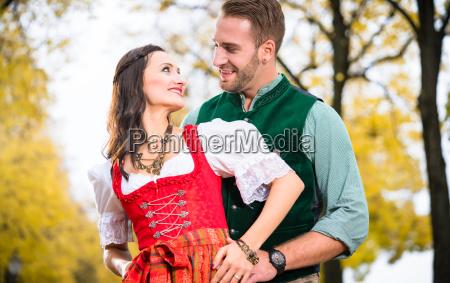 bavarian couple in autumn hug