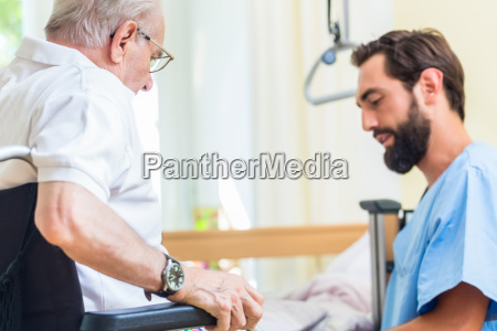 elderly care nurse helping senior from