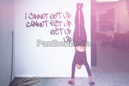 fit woman in perfect handstand against