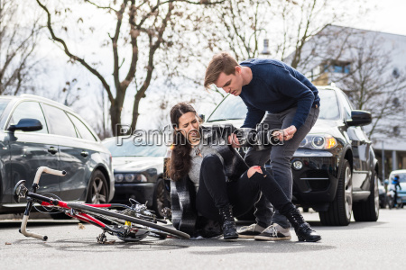 reliable young man helping an injured