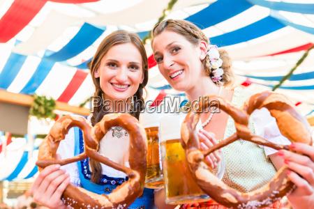 friends at bavarian fair with giant