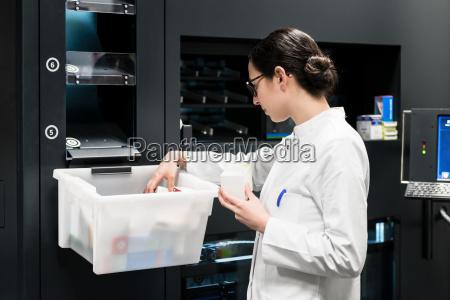 pharmacist choosing the best medicines during