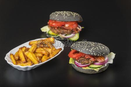 closeup of black hamburgers on black