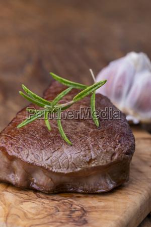 grilled steak on cutting board