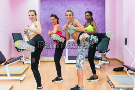 cheerful fit women doing a lateral