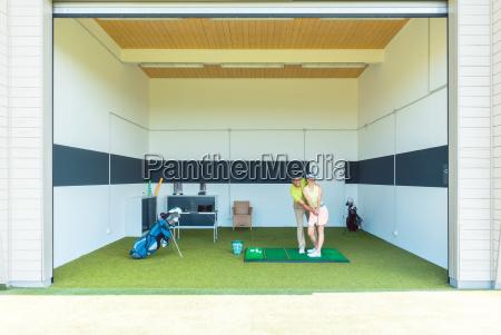 dedicated golf coach using modern equipment