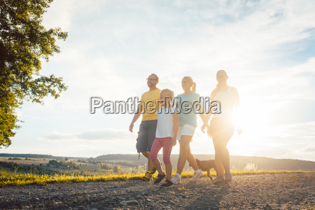 family having an evening walk with