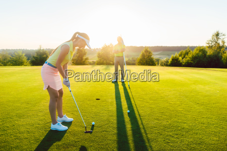 female golf player ready to hit