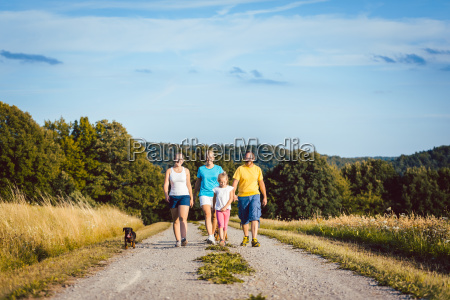 family walking their dog on a