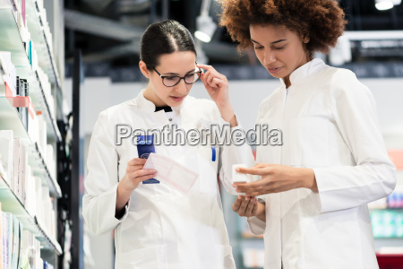 reliable pharmacists analyzing a prescription and
