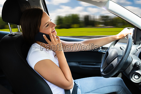 woman talking on cellphone while driving