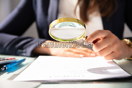 businesswoman looking at contract form through