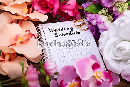 wedding schedule on spiral notepad with
