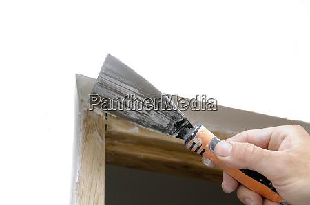 mason applying plaster