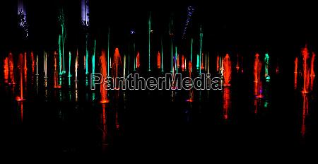 illuminated water splash by night in