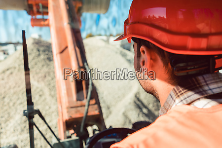 worker on construction site operating wheel